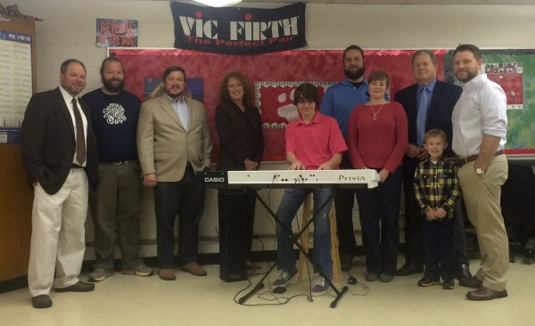 Rooster Walk Inc. and American Global Logistics partnered in memory of the late Todd Eure to purchase this new Casio Privia keyboard for the Martinsville High School Jazz Band. Pictured are (from left): MHS Band Director Kevin Lewis; rooster Walk Chief Operating Officer William Baptist; Rooster Walk Inc. Board President Jason Lagesse; Woodall's Music and Sound owner Sandy Woodall; current MHS senior and Jazz Band member Will Seamon; Rooster Walk Executive Director Johnny Buck; Courtney Harrington Eure; Danny Eure; Carter Eure; and AGL General Manager Blake Shumate.